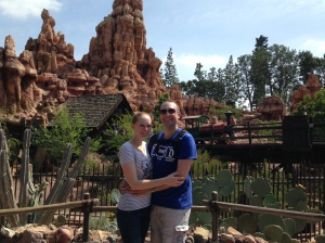Tom and Leslie enjoying a picture in front of Big Thunder Mountain, just as a train screams by.